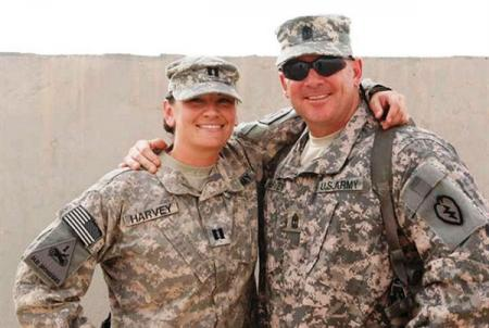 Sept. 10, 2010 -- Army Capt. Tanya Rosa and Army 1st Sgt. Greg Harvey spend time together in Kuwait, the first time the siblings had seen each other in five years. Rosa wore her maiden name tape in the photo as a surprise for their parents. Courtesy photo