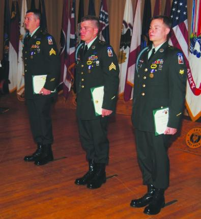 Sgt. Stuart Fredieu (left), Sgt. Coty Clare (center) and Spc. Ryan Guillot, Alpha Company, 1st Battalion (Airborne), 509th Infantry Regiment, receive Soldiers Medals during a ceremony Dec. 15, 2010 at Fort Polk's Bayou Theater. The Soldiers saved the life of an unconscious man trapped in a burning vehicle April 25, 2010.