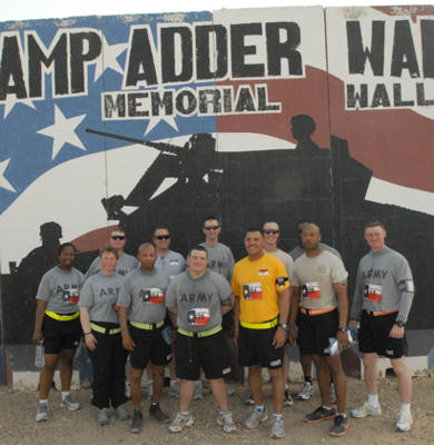 Louisiana National Guard Soldiers with the 2nd Squadron, 108th Cavalry Regiment, headquartered in Shreveport, La., pose after the 36th Sustainment Brigade's Texas Memorial 10k on Contingency Operating Base Adder, Iraq, on May 30, 2010. Louisiana's Cavalry Squadron is currently deployed in support of Operation Iraqi Freedom.