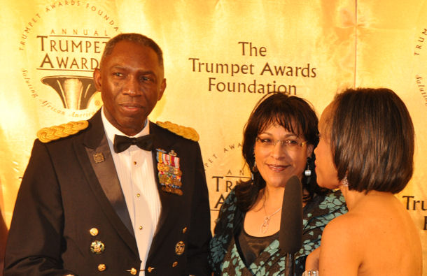 Gen. William E. Ward, commander, U.S. Africa Command, and his wife, Joyce, speak with media on the red carpet before entering the 18th Annual Trumpet Awards event.