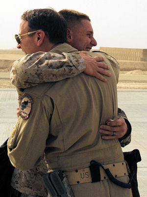 Marine 1st Lt. Benjamin Boera, (left) hugs his dad, Brig. Gen. Michael R. Boera, March 28, 2010, at Camp Bastion, Afghanistan. Lieutenant Boera is a 5th Battalion 11th Marines High Mobility Artillery Rocket System Tango Battery platoon commander. General Boera is the 438th Air Expeditionary Wing and Combined Air Power Transition Force commander.