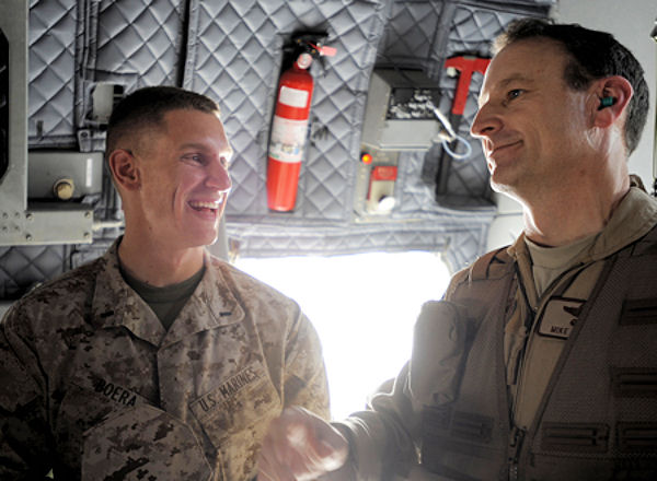 Marine 1st Lt. Benjamin Boera, (left) and his dad, Brig. Gen. Michael R. Boera share a laugh aboard an Afghan National Army Air Corps C-27A Spartan March 28, 2010, at Camp Bastion, Afghanistan. Lieutenant Boera is a 5th Battalion 11th Marines High Mobility Artillery Rocket System Tango Battery platoon commander. General Boera is the 438th Air Expeditionary Wing and Combined Air Power Transition Force commander.