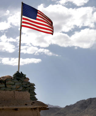 The American flag sways in the wind at Forward Operating base Baylough in Afghanistan's Zabul province, June 6, 2010.