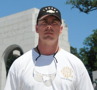 John McAllister, a veteran who served both in the National Guard and the U.S. Air Force, stands at the World War II Memorial in Washington. D.C., July 1, 2010. In an interview McAllister reflected on the dramatic impact military service has had on his life. DOD photo by USN Petty Officer Second Class William Selby