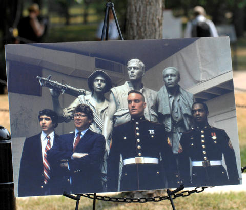 A portrait of the original Three Servicemen Statue, its models and creator, Frederick Hart, second from left, is on view during a rededication ceremony for the statue at Lincoln Circle near the National Mall in Washington, D.C., July 8, 2010. The statue, created in 1984, underwent six weeks of restoration work to remove damage and restore the original patina.