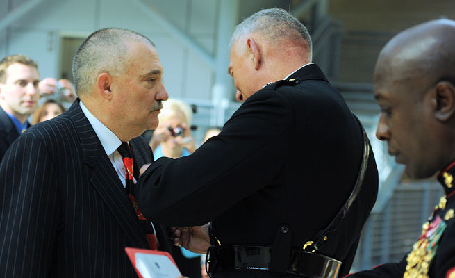 "Former Navy Hospital Man 2nd Class Dennis ""Doc"" Noah, a corpsman with 2nd Battalion, 5th Marine Regiment, 1st Marine Division, during the Vietnam War, is awarded the Silver Star by the commandant of the Marine Corps, Gen. James T. Conway, during a ceremony April 7 at the National Museum of the Marine Corps."