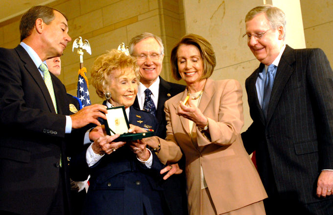 Deanie Parrish, a World War II Women Airforce Service Pilot and associate director of Wings Across America, accepts the Congressional Gold Medal on behalf of her fellow WASPs at the U.S. Capitol, March 10, 2010. Presenting the medal are House Speaker Nancy Pelosi; House Minority Leader John Boehner, Senate Majority Leader Harry Reid and Senate Minority Leader Mitch McConnell.