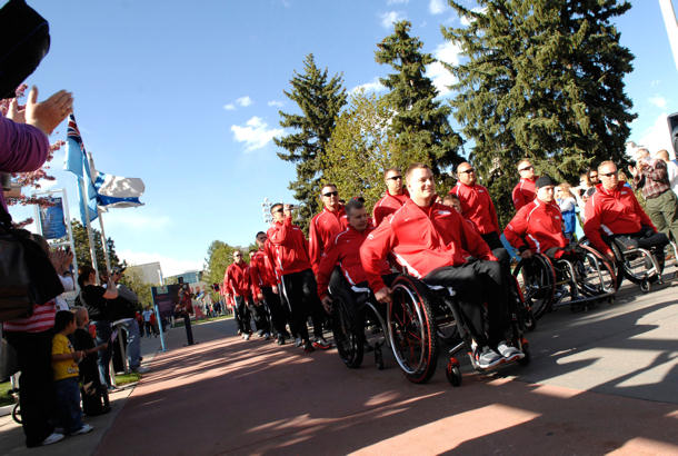 Team Marine Corps marches down Olympic Path to a cheering crowd during the opening ceremony of the inaugural Warrior Games at the U.S. Olympic Training Center in Colorado Springs, Colo., May 10, 2010.