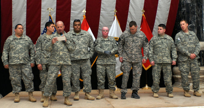 Command Sgt. Maj. Lawrence Wilson, United States Forces-Iraq command sergeant major, introduces the wounded warriors of Operation Proper Exit IV, Jan. 31, 2010 at the Al Faw Palace in Baghdad, Iraq. (Left to right) Cpl. Charles Dominguez, Sgt. Jay Fain, Sgt. Omar Avila, Sgt. 1st Class Michael Schlitz, Master Sgt. Tom Carpenter, Capt. Ferris Butler and Capt. Lonnie Moore.