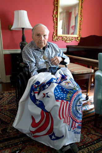 Charles Town, WV (July 2010) -- Frank Buckles, who is 109 and the last surviving American World War One veteran, sits with the Spirit of America flag. Photo by David DeJonge