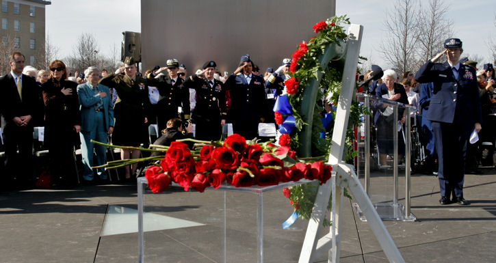 Women Airforce Service Pilots of World War II, military members and guests salute a wreath and roses dedicated to the 38 out of 1,102 women pilots who died during service to their country during a ceremony at the Air Force Memorial in Arlington, Va., March 9, 2010. The ceremony was part of an event in which all pilots will be awarded the Congressional Gold Medal at the U.S. Capitol. The women were civilian pilots and the first to fly military aircraft under the direction of U.S. forces. Fewer than 300 women are alive and more than half were expected to attend the events.