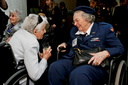 "Ola ""Roxie"" Rexroat and Maxine Flournoy, both former pilots who flew with the Women Airforce Service Pilots during World War II, meet during a reception to honor the 1,102 pilots at the Women in Military Service For America Memorial at Arlington National Cemetery, Va., March 9, 2010."