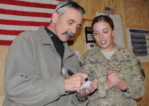 Pfc. Natascha Taylor, of Colorado Springs, Colo., currently deployed to Afghanistan with the 504th Battlefield Surveillance Brigade, gets an autograph from country music artist Aaron Tippin Nov. 27, 2011 at Forward Operating Base Spin Boldak, Afghanistan. Deployed in support of Operation Enduring Freedom, Taylor and the soldiers of the 504th BfSB are often without entertainment during the holiday season. Photo by Army Sgt. Marc Loi