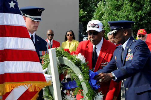 Maj. Gen. Darren W. McDew, the Air Force District of Washington commander, and Jim Pryde, a Tuskegee Airman, lay a wreath at the U.S. Air Force Memorial on July 31, 2011, in Washington, D.C. Pryde served with the Army Air Corps' 477th Medium Bombardment Group as a combat crewman. During his tenure, he accrued 1,600 flight hours before continuing his civil service career as an intelligence analyst with the Armed Forces Security Agency. (U.S. Air Force photo by Staff Sgt. Raymond Mills)