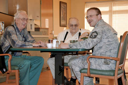 Senior Master Sgt. Tadd Goehring enjoys a chat with residents of the Eastern Nebraska Veterans Home Feb. 16, 2011, near Offutt Air Force Base, Neb. Sergeant Goehring is assigned to the 55th Aircraft Maintenance Squadron. U.S. Air Force photo/Jeff W. Gates