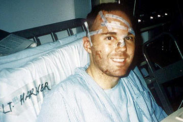 Then 1st Lt. Mike Harner smiles for the camera in a hospital bed while recovering from injuries sustained in the bombing of Khobar Towers in Dhahran, Saudi Arabia, June 25, 1996. Lt. Col. Mike Harner is now the commander of the 14th Civil Engineering Squadron at Columbus Air Force Base, Miss. (Courtesy photo)