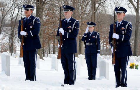 Members of the 375th Air Mobility Wing Honor Guard firing party salute during a funeral procession, Jan. 21, 2011 at the Jefferson Barracks National Cemetery, Mo. The Scott Air Force Base, Ill., Honor Guard performs numerous details for veterans at this cemetery as well as covering funerals throughout a four state region. Airmen of all ranks and units are assigned to the Honor Guard for four months at a time. UASF photo by Staff Sgt. Brian J. Valencia