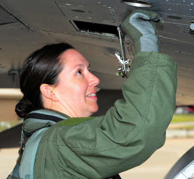 Capt. Betsy Hand, 20th Operations Group standard evaluations liaison officer and 77th Fighter Squadron F-16 pilot, inspects an F-16, March 30, 2011.