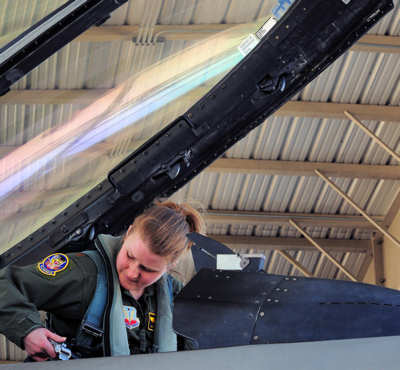 Maj. Jaime Nordin, 79th Fighter Squadron F-16 pilot, checks out the cockpit of an F-16 to ensure everything is in order, March 26, 2011.