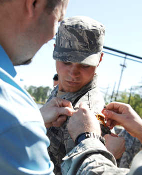 Airman 1st Class Matthew Garner has his Ranger tab pinned on by his father, Don Garner, and mentor, Staff Sgt. Seth Hunter, April 29, 2011. after completing the intense 61-day U.S. Army Ranger School at Ft. Benning, Ga. Airman Garner was the only Airman to make it through the course for this class and is one of fewer than 300 to make it since the school opened in the 1950s. Airman Garner is assigned to the 823rd Base Defense Squadron.