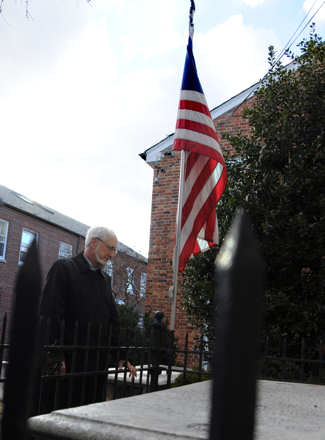 Donald C. Dahmann, historian at the Old Presbyterian Meeting House, pauses at the Tomb of the Unknown Soldier of the American Revolution.