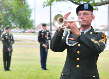 Army Sgt. 1st Class Andrew Phelps, a bugler with the 1st Cavalry Division Band, plays taps during the 15th Brigade Support Battalion's Memorial Ceremony for Spc. Justin Richardson on Fort Hood, Texas, April 7, 2011. Photo by Army Sgt. Quentin Johnson