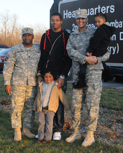 "The Armstrong family stands outside the 2nd Brigade Combat Team headquarters Nov. 21, 2011. From left, Sgt. 1st Class Everett Armstrong; Devyn, 17; Everett ""E.J.,"" 4; Warrant Officer Julia Armstrong and Trinity, 4. Not pictured: Stephon, 15, who lives in Dallas. Army photo by Michelle Kennedy"
