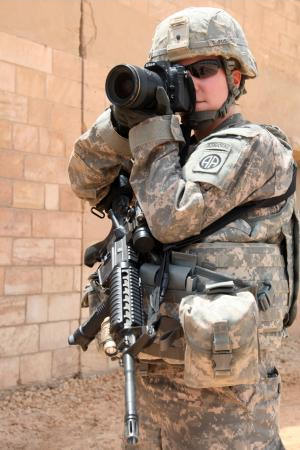 Army Sgt. Kissta Feldner, public affairs photojournalist for the 82nd Airborne Division's 2nd Advise and Assist Brigade, takes photos in Iraq's Anbar province, July 30, 2011. Photo by Sgt. Kissta Feldner