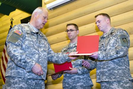 Maj. Gen. R. Martin Umbarger, Indiana National Guard adjutant general, awards 2nd Lt. Tracy Fields of Mishawaka, Ind., and Spc. Dustin Winebrenner of Auburn, Ind., with the National Guard Association of the United States Valley Forge Cross for Heroism at Camp Atterbury, Ind., April 9, 2011.
