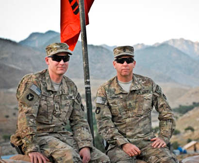 Army Staff Sgt. Rich Fiedler, left, and his brother, Army Sgt. 1st Class Tim Fiedler, right, sit together June 14, 2011, on Combat Outpost Najil in Afghanistan's Laghman province. The Fiedler brothers have more than 50 years of combined service in the Iowa National Guard's Company A, 1st Battalion, 133rd Infantry Regiment. U.S. Army photo by Capt. Jason Beck