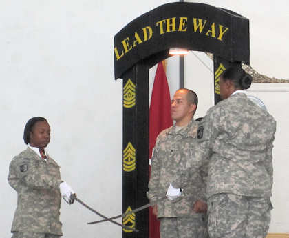 Sgt. Socorro Garcia, an administrative non-commissioned officer with the 101st Sustainment Brigade, prepares to step through the archway of the newly promoted non-commissioned officers during a ceremony at Bagram Air Field, Afghanistan on Sept. 21, 2011. Photo by Army Sgt. 1st Class Mary Perez
