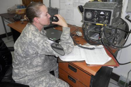 Pfc. Tabatha Krohn, Headquarters and Headquarters Company, 3rd Brigade Special Troops Battalion, 3rd Advise and Assist Brigade, 1st Cavalry Division mans the radio desk at entry control point five, Sept. 5, 2011. Krohn is responsible for helping conduct background checks of personnel identified through biometric checks at Contingency Operating Base Adder, Iraq. U.S. Army photo by 2nd Lt. Jennifer Farland
