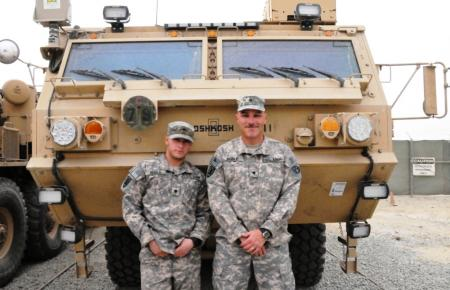 Spc. Codie Noble (left) stands next to his father, Spc. Jeffery Noble, both truck drivers and Bloomfield, Iowa, natives, 428th Transportation Company, Joint Logistics Task Force 7, 1st Sustainment Brigade on February 3, 2011. The Nobles are deployed to Camp Arifjan, Kuwait, in support of Operation New Dawn.