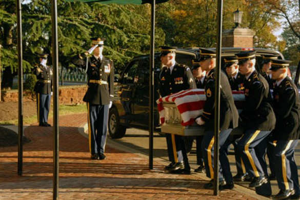 Old Guard Soldiers with casket during military funeral ceremony.