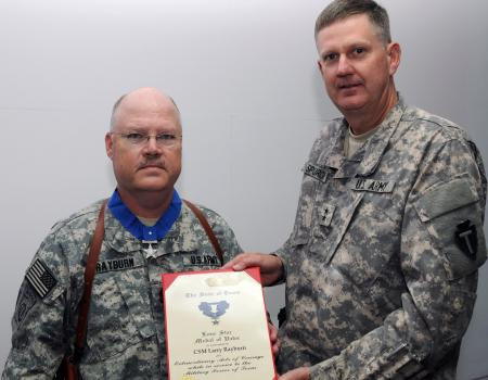 "Sgt. Maj. Larry Rayburn, information operations sergeant major with the 36th Infantry Division headquarters in Basrah, Iraq, received the Texas Medal of Valor from Maj. Gen. Eddy M. Spurgin, 36th Infantry Division commanding general on May 1, 2011. Rayburn earned the second highest Texas award for his actions during an ill-fated training exercise in Germany in 1985 when he was a lead scout with 2nd Platoon, Company G, 143rd Infantry (Airborne Ranger). Rayburn was one of two men, of a five-man ""stick"", who escaped injury during an All-Weather Delivery System parachute jump. This was the first such jump for members of the Texas Army National Guard."