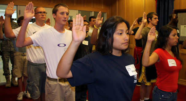 Recruits, most schoolchildren during the 9/11 terror attacks, raise their right hands at the Baltimore Military Entrance Processing Station to take their oath of enlistment, Aug. 16, 2011. DOD photo by Donna Miles