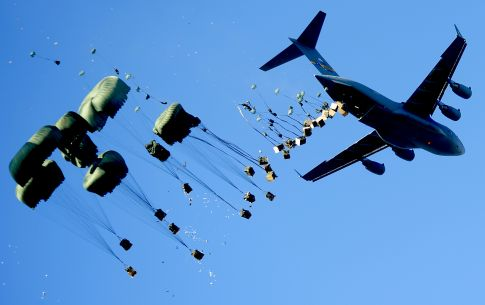 A C-17 Globemaster III drops pallets of water and food over Mirebalais, Haiti, Jan. 21, 2010, to be distributed by members of the United Nations. The aircraft is from the 437th Airlift Wing at Charleston Air Force Base, S.C. (U.S. Air Force photo/Tech. Sgt. James L. Harper Jr.)