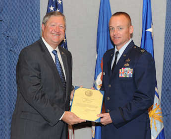 Secretary of the Air Force Michael Donley presents the Lt. William Cheney Award to Capt. Patrick R. Markey during a ceremony at the Pentagon Oct. 27, 2011. U.S. Air Force photo by Andy Morataya