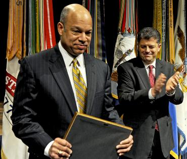 Michael L. Rhodes, the Defense Department's director of administration and management, applauds Jeh C. Johnson, the department's general counsel, after presenting him a certificate of appreciation for his keynote address at the 26th annual observance of the life of Dr. Martin Luther King Jr. at the Pentagon, Jan. 13, 2011. DOD photo by R. D. Ward