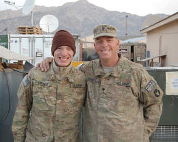 Army Pfc. Andrew Starkey and his father, Army Spc. Steve Starkey of the Iowa Army National Guard pose for a photo Jan. 6, 2011, while deployed to Afghanistan's Paktia province. Courtesy photo