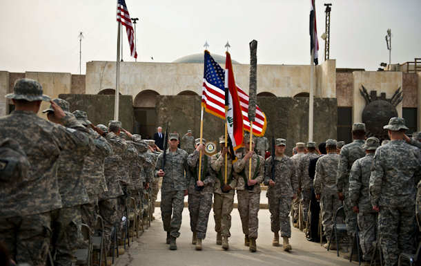 U.S. service members retire the colors during a ceremony marking the end of the U.S. military mission in Iraq in Baghdad, Dec. 15, 2011. DOD photo by Erin A. Kirk-Cuomo