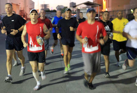 Maj. Jesse Sjoberg (left center), Marine Forces Central Command Forward, leads the way as Marines and sailors with Marine Forces Central Command Forward run alongside during a 65 mile run, Oct. 6-7, 2011 at Naval Support Activity Bahrain. Sjoberg's wife suffers from a deadly lung disease called cystic fibrosis. He ran the event to raise awareness and funds for the Cystic Fibrosis Foundation. Photo by USMC Cpl. Lucas Vega
