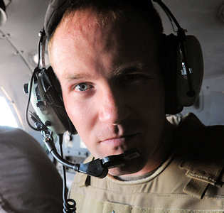 Retired Marine Cpl. Donny Daughenbaugh rides in the cockpit of an Air Force C-130. Daughenbaugh was one of the wounded warriors who participated in Operation Proper Exit IX and stepped back into Iraq, April 25, 2011.