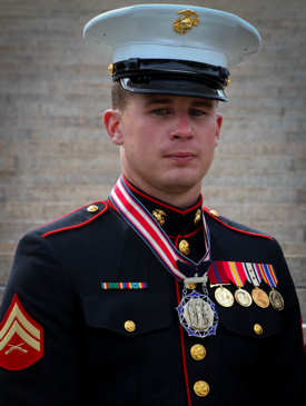Corporal Christopher Conley, a crew chief with 2nd Assault Amphibian Battalion, 2nd Marine Division, poses with the Citizen Service Before Self Honors Medal during a ceremony at Arlington National Cemetery March 25, 2011. Conley received the award on behalf of his mother, Marie Conley of Boston, who was recognized for sacrificing her own life to save a young boy by shielding him with her own body from a car that was barreling towards him October 21, 2008. Photo by USMC Sgt. Michael S. Cifuentes
