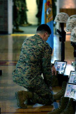 A Marine with Regimental Combat Team 2 mourns the loss of a fellow comrad during a memorial service aboard Marine Corps Base Camp Lejeune, N.C., Feb. 23, 2011. The regiment's 87 lives lost during the recent year-long deployment of RCT-2 was the greatest total loss of any regiment that fought in support of Operation Enduring Freedom.