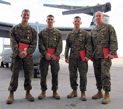 Marines from Marine Medium Tiltrotor Squadron 264 were awarded the Air Medal for heroic actions in support of Operation Enduring Freedom, Dec. 16, 2011. (From left to right) Cpl. John M. Cederholm, the mission crew chief, Sgt. Justin K. Bartfield-Smith, the mission aerial gunner and observer, Capt. Matthew A. Cave, the mission co-pilot, and Capt. Thomas M. Keech, the mission pilot, were recognized for actions during a priority re-supply mission in support of 1st Battalion, 5th Marine Regiment, in the Sangin River Valley, Afghanistan, June 12, 2011. This mission was the first time an MV-22B had engaged an enemy in Afghanistan. Photo by USMC Cpl. Abigail Brown