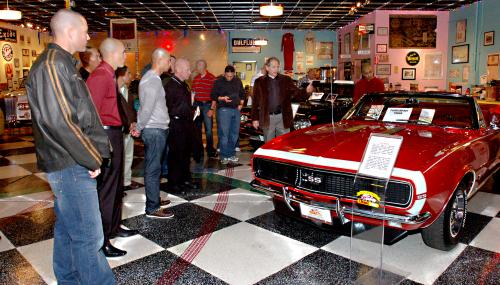 Bob Rabourne, community outreach representative, Only Yesterday Classic Auto and Hall of Heroes, briefly explains the history of Spielman's 1967 Chevrolet SS convertible to Marine Drill Instructors of Marine Corps Recruit Depot San Diego Jan. 7, 2011. The tour of Spielman's private collection was an opportunity to gain a greater appreciation of 20th century Americana and learn more about military history from different perspectives.