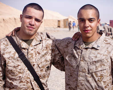 CAMP DWYER, Afghanistan (Nov. 20, 2011) - Cpl. Axel Benitez (left), a radio operator with Combat Logistics Battalion 1, poses for a picture with his brother Cpl. Luis Benitez, a data network specialist with 1st Battalion, 3rd Marine Regiment. This is the first time the brothers have seen each other in more than 2 years and the first time as Marines. Photo by USMC Cpl. Colby Brown