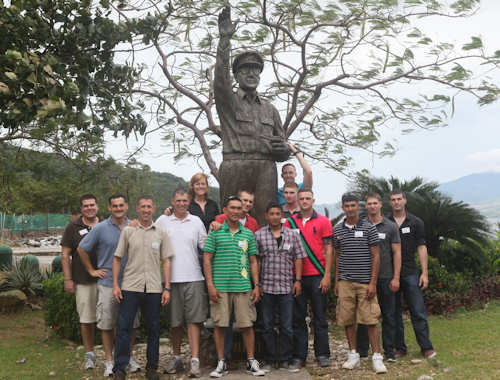 U.S. Marines with the 31st Marine Expeditionary Unit take a group photo in front of a statue of Gen. Douglas MacArthur, during a tour here on Nov. 04, 2011. The statue was erected at the location of MacArthur's departure from the Philippines prior to the fall of Corregidor in 1942. Photo by USMC Lance Cpl. David J. Adams