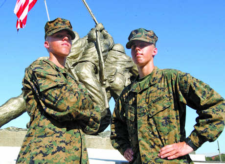 Pfcs. Brian and Matthew Lentz, Alpha Company, 1st Recruit Training Battalion, on Marine boot camp graduation day (Nov. 21, 2011) after 13 weeks apart. The two brothers chose to go through training in separate platoons. Photo by USMC Lance Cpl. Francisco Abundes